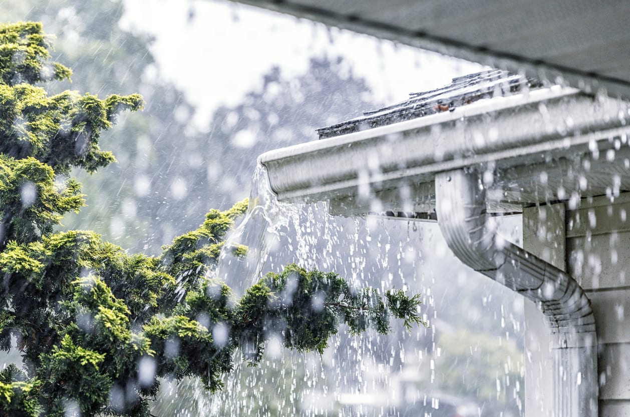 Torrential Summer Rain Storm Water Overflowing Roof Gutters